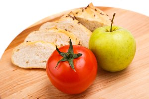 white bread with beans, tomato, Apple on a wooden tray