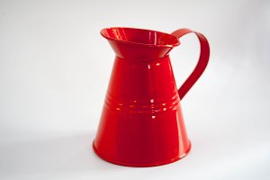 Bright red tin watering can