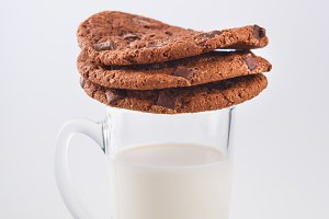 American biscuits with chocolate, a glass of milk isolated