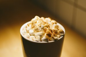 cocoa with marshmallows in a white Cup in a cafe