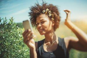 Black girl is making selfie