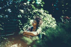 Cute ebony girl in private park