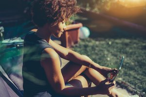 Afro girl with digital tablet