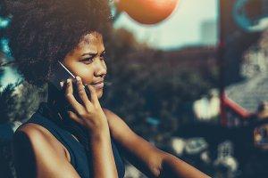 Mixed girl calling via smartphone