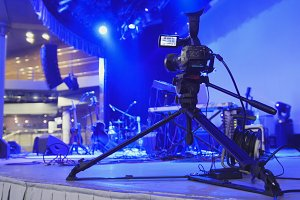 Video camera stands on the stage - abstract blurred