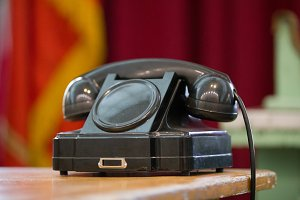 Vintage telephone on old table