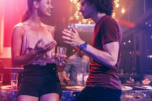 Young couple enjoying at a nightclub