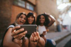 Female friends making selfie