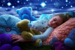 Little girl sleeping with teddy bear in bed, dreaming the starry sky at bedtime night
