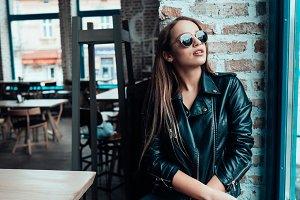 Beautiful girl in sunglasses posing on camera
