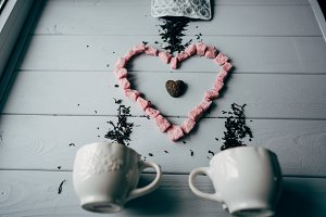 A white mug with pink heart