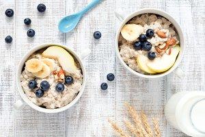 Oatmeal porridge on white table