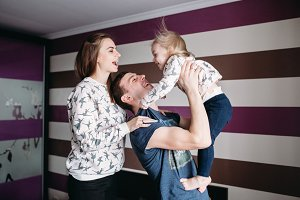 Mom, Dad and little girl having fun together