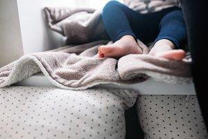 The legs of a little girl