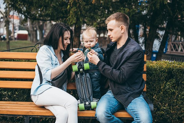 Young family on bench