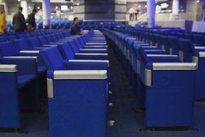 Blue chairs in a concert hall, de-focused