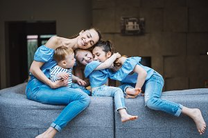 Mom, two daughters and a little son on the couch
