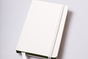Paper notepad blank cover on white