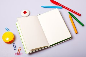 Open paper notepad with blank pages