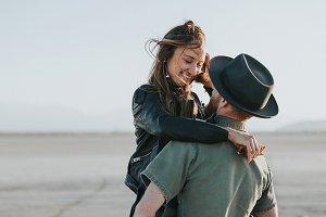 hipster couple in the desert