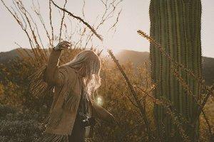 hipster girl dancing in the desert