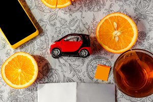 Juicy oranges toy car and hot tea