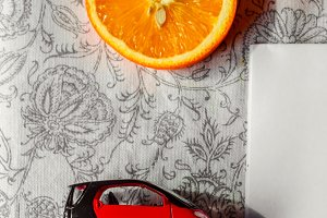 Citrus and yellow phone with red car