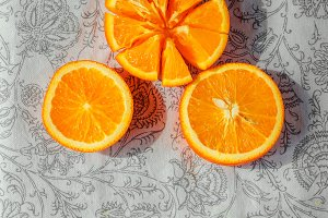 Fresh citrus oranges on a tablecloth lie