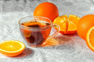 Hot black tea. citrus fruit