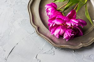 Rustic table setting with peonies