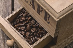 Coffee Beans In Vintage Grinder
