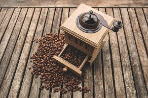 Coffee In Vintage Grinder Background