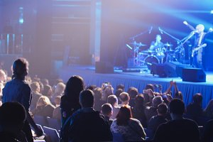Rock concert - crowd in auditorium listening performance