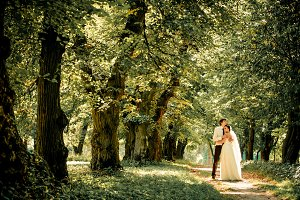 happy bride and groom on a walk