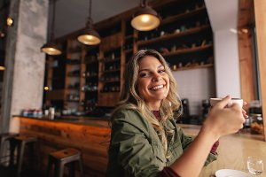Smiling woman sitting at cafe