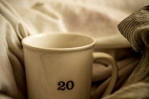 large Cup with hot drink in bed