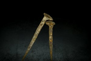 old rusty nails on black background