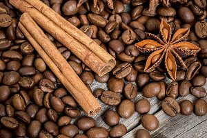 Coffee, cinnamon and Damian on wooden background
