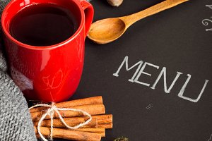 Black leaf menu with red Cup