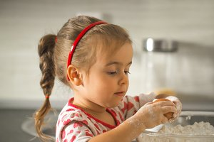 beautiful little girl Baker on kitchen