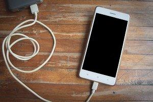 smart phone on wood table
