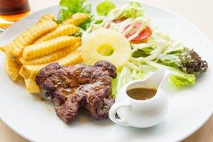 steak pork fried and pineapple salad