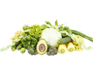 Diet concept: Set of green fruits and vegetables, isolated
