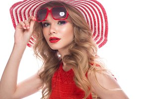 Bright cheerful girl in summer hat, colorful make-up, curls and pink manicure. Beauty face.