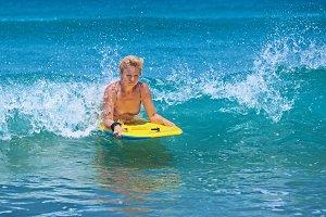 Woman surfing on bodyboard