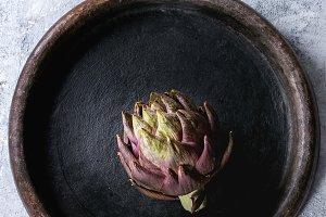 Uncooked purple artichoke