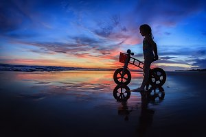 Child on sunset beach
