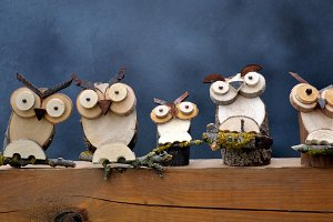 Row wooden owls