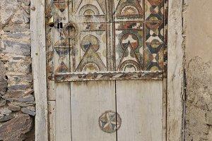 Half painted old wooden berber door