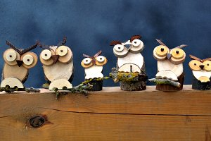 Row wooden owls handmade